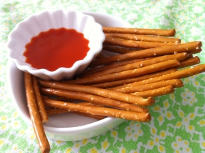 Pretzel sticks with straight Frank's Buffalo Wing Sauce